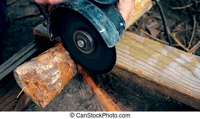 Cutting rusted iron pipe with an angle grinder - Cutting old...