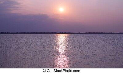 Sunrise over lake or river with sun path - Sunrise over lake...