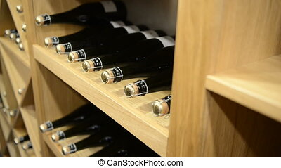 Bottles of wine and champagne in a cellar - Rows of Bottles...