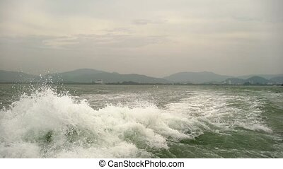 Waves from big ship in the sea