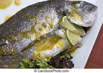 Fresh silver bream served with poached potatoes and two...