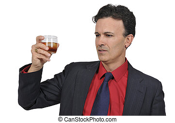 Business man with a cocktail - Handsome business man holding...