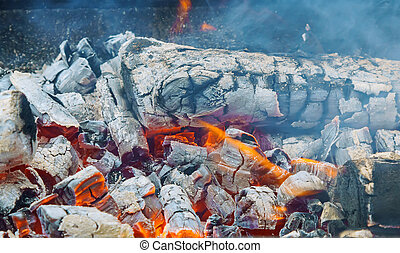 Flaming Charcoal In BBQ Grill Pit Isolated On Black...