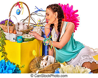 Woman in easter style holding bunny and flowers. - Easter...