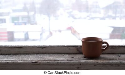 Time lapse of cars moving on city road in winter with a cup...