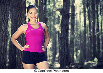 Woman runner in forest