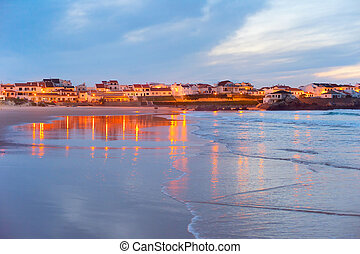 Coastal town at twilight. Portugal - Town on the ocean shore...