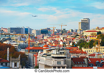 Travel to Lisbon, Portugal - Airplane flying over Lisbon...
