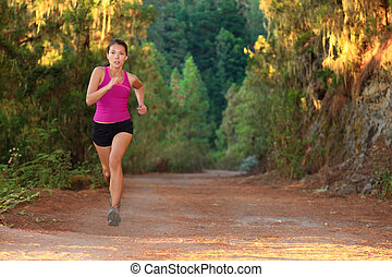Running woman - Female athlete running on forest road - copy...