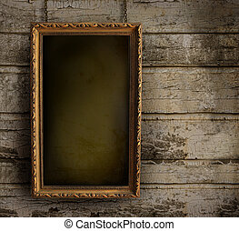 Old frame against a peeling painted wall - Old frame against...