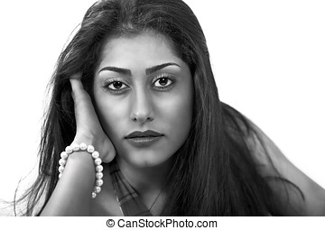 Soulful woman of ethnic origin, a face portrait
