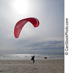 Paragliding On Oregon Coast - A woman about to take off for...