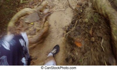 Man hiking in path in jungle pov