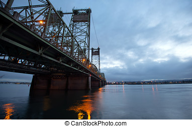 Bascule bridge truss arch metal Interstate I-5 Columbia river reflection night lights