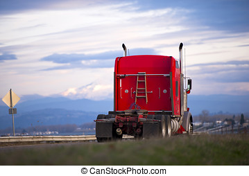 Red classic semi-truck with wooden staircase on scenic road...