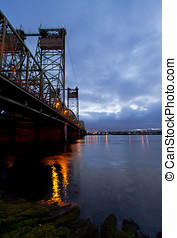 Evening Big Lifting Bridge over Columbia River with lights...