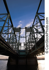 Bridge with steel trusses and lifting towers on a wide...