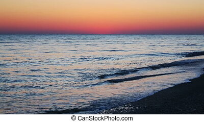Seaside Sundown Loop - A colorful sky, after sunset, tops...