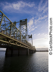 Metal truss bridge with triangles and towers across Columbia...