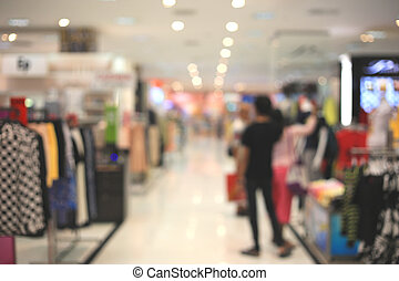 Blurry de-focused shopping mall store background.