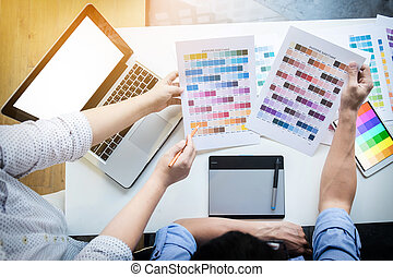 Graphic designers meeting to discuss new ideas at office....
