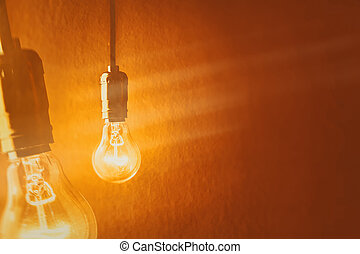 light bulb on orange background