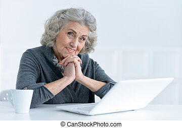 mature woman working at office