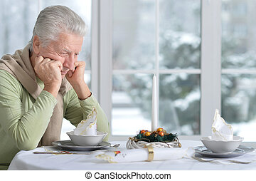 upset senior man in cafe, waiting for somebody