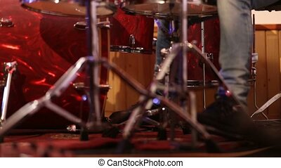 Drummer on stage playing kick drum - Low section of drummer...