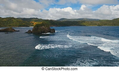 Seascape with tropical island, rocks and waves. Catanduanes,...