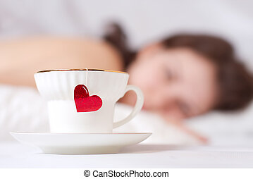 romantic morning - cup of tea with heart and beautiful girl...