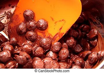 Melting of chocolate and orange shovel - Melted the...