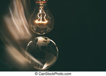 Light bulb and earth, concept of global issues