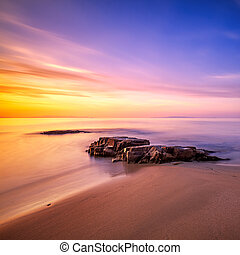 Rocks in Cala Violina beach in Maremma on sunset, Tuscany....