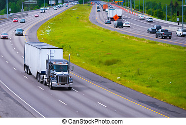 Divided Highway Curve large semi truck with bulk trailer - A...