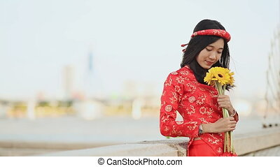 Beautiful Vietnamese girl in red traditional dress Ao Dai...