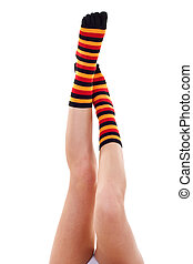 feet in colored socks - Young sweet girls foot in a colorful...