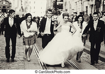 A balck and white picture with warlike bride walking with...
