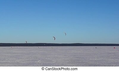 Extreme kite surfing on the lake in winter