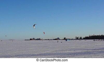Kite surfing on winter lake