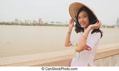 Vietnam girl in the national costume and dress Ao Dai posing...
