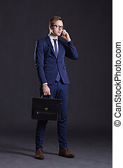 Young and confident business man. Businessman in suit over...
