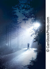 date - silhouette couple stand together in the moonlight