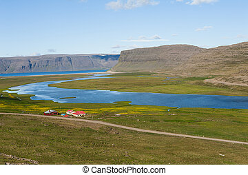 West Fjords - Mighty fjords rise from the sea and a farm....