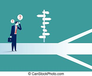 Businessman standing confused by direction sign