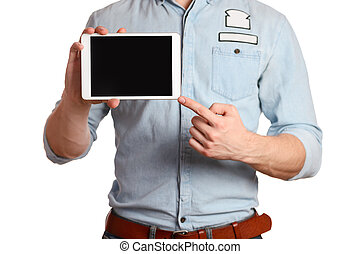 A man in a light blue shirt and jeans with a brown belt is holding tablet pc isolated on white background