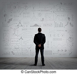 Businessman standing over schematic background. Business and...