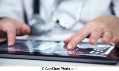 Hand Using Tablet With X-ray - Doctor Hands Examines An...