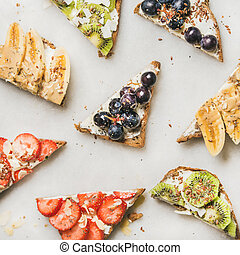 Healthy breakfast toasts cut in pieces, square crop -...
