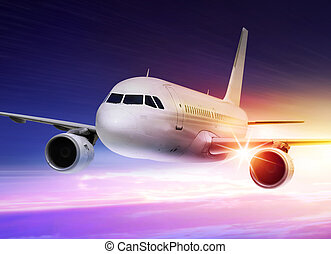 accelerated plane at sunset - passenger plane is accelerated...